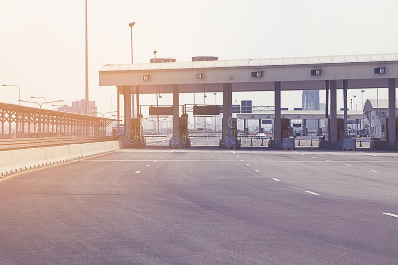 Road signs and toll booth. Road signs toll booth on sunny summer day stock photo