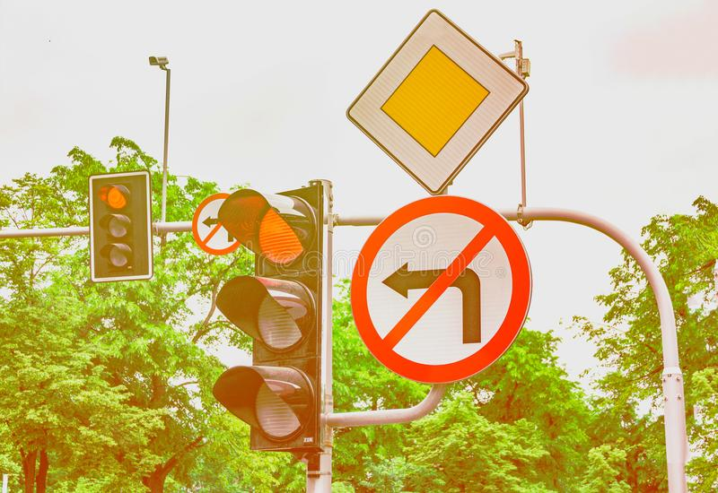 Road signs, the traffic light is red, the turn to the left is forbidden. Road signs, the traffic light is red, the turn to the left royalty free stock photography