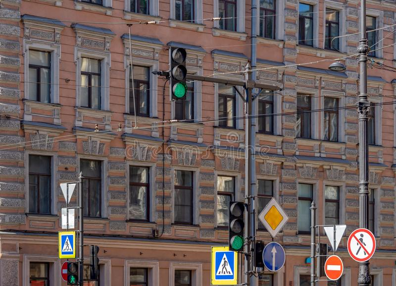 Road signs and traffic lights on the street of the old city royalty free stock photos