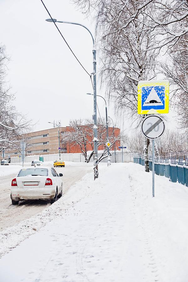 Road signs under the snow near the fence royalty free stock photos