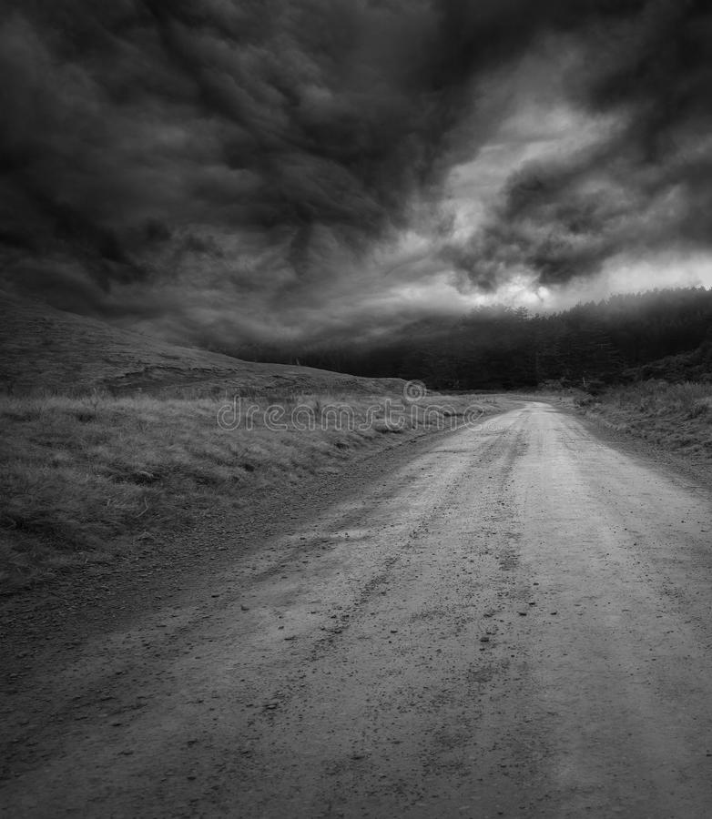 Road and sky. Empty road and dark sky stock images