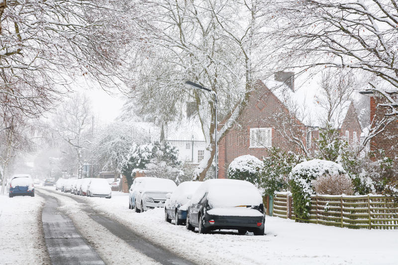 Road in snow. Snow covered suburban street in England, United Kingdom royalty free stock image