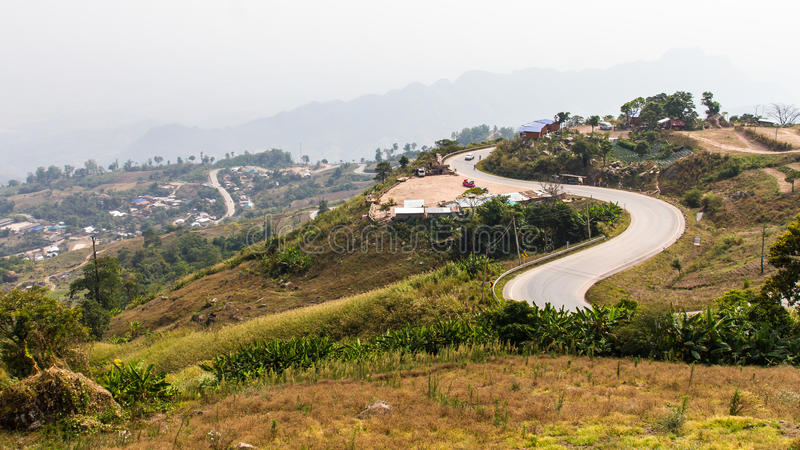 Road on a steep hill. Crooked path of the road on a steep hill, which is full of resort living royalty free stock images