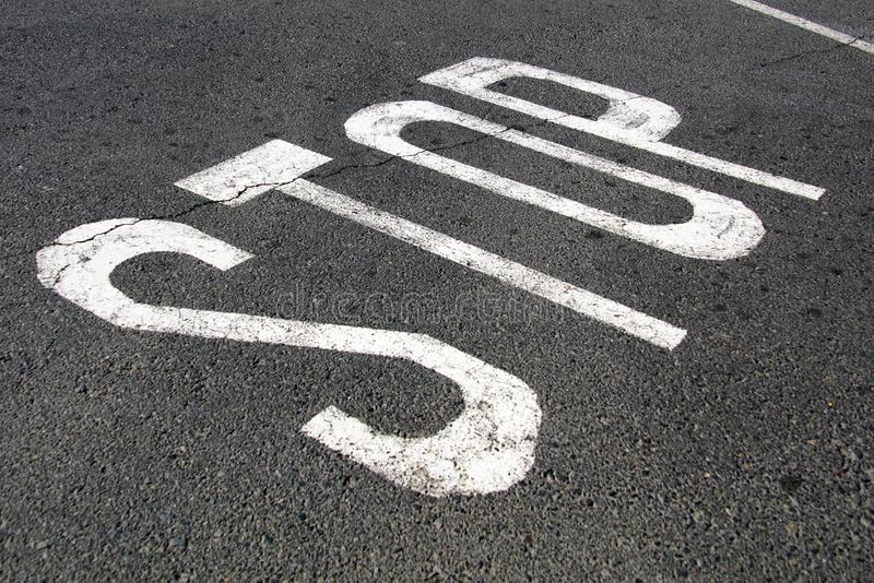 Road stop sign. Asphalt road marking stop sign royalty free stock photo