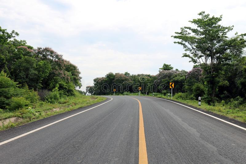 Road, street, avenue roadway, countryside road and curve traffic signs in the left Thailand. The road, street, avenue roadway, countryside road and curve traffic stock photos