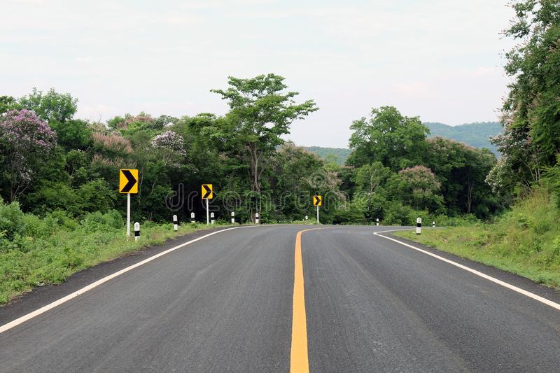 Road, street, avenue roadway, countryside road and curve traffic signs right in Thailand. The road, street, avenue roadway, countryside road and curve traffic stock images