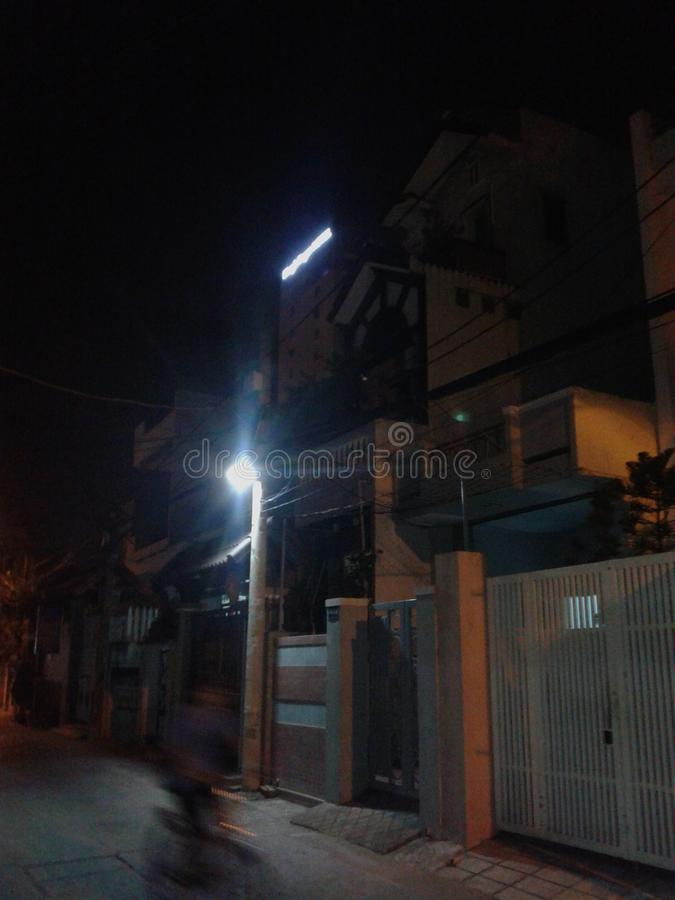 Road street vietnam night bike blur. Night scene in a back street in Vietnam stock photography