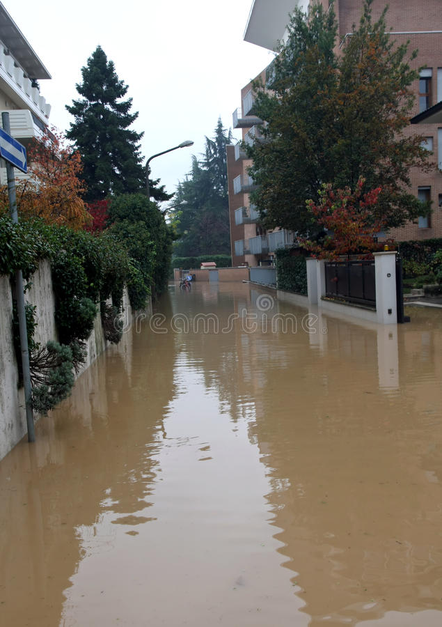 Road submerged by the mud during the flood. In the city stock image