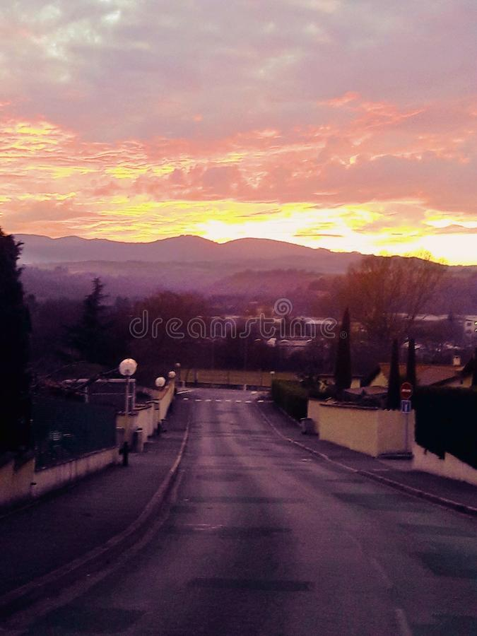 Road at sunset stock photography