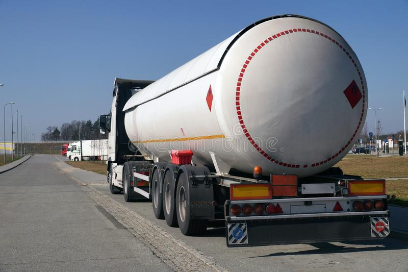 Road tanker with thermal insulation designed for the carriage flammable substances. Truck with a specialist semi-trailer stock photos