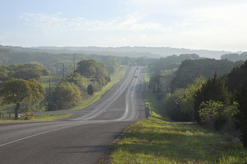 Road in the Texas Hill Country near sundown stock photo