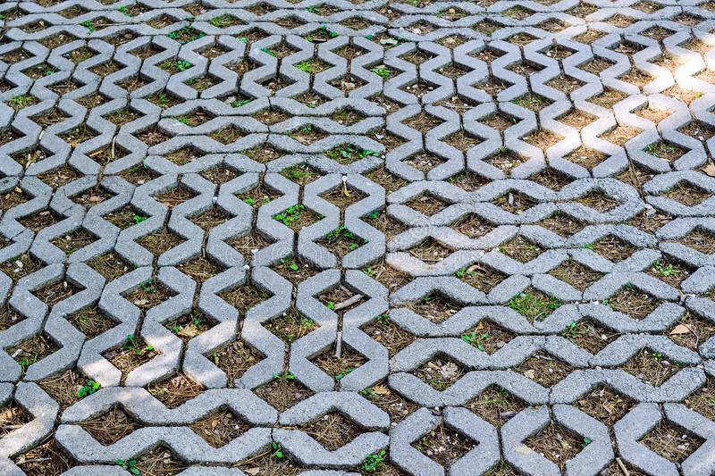 The road is tiled on the ground. Patern of concrete elements. The road is tiled on the ground. Patern of concrete elements royalty free stock images