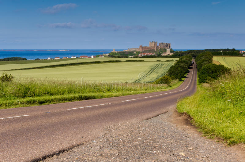 Road to Bamburgh Castle. Approach to Bamburgh and its Castle royalty free stock photo