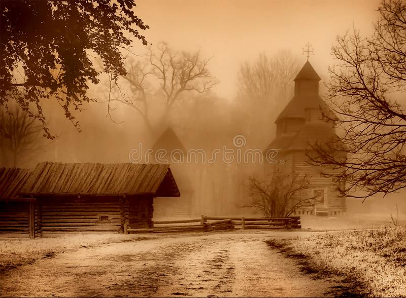 The road to the church and old house in the haze. royalty free stock photography