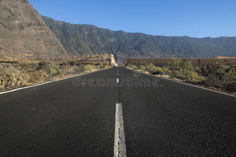 The road to El Golfo. Cliffs and mountains of El Golfo, El Hierro stock photography