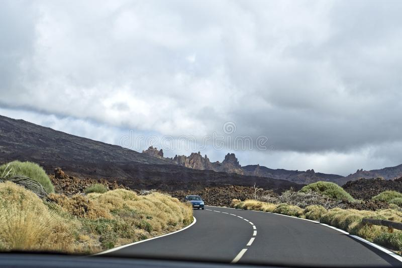 Road to foggy clouds on the track to the Teide volcano in Tenerife with a car window, natural background stock photos