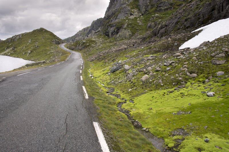 Road to Haugesund in Norway. Way between clouds and mountains in Haugesund in Norway stock image