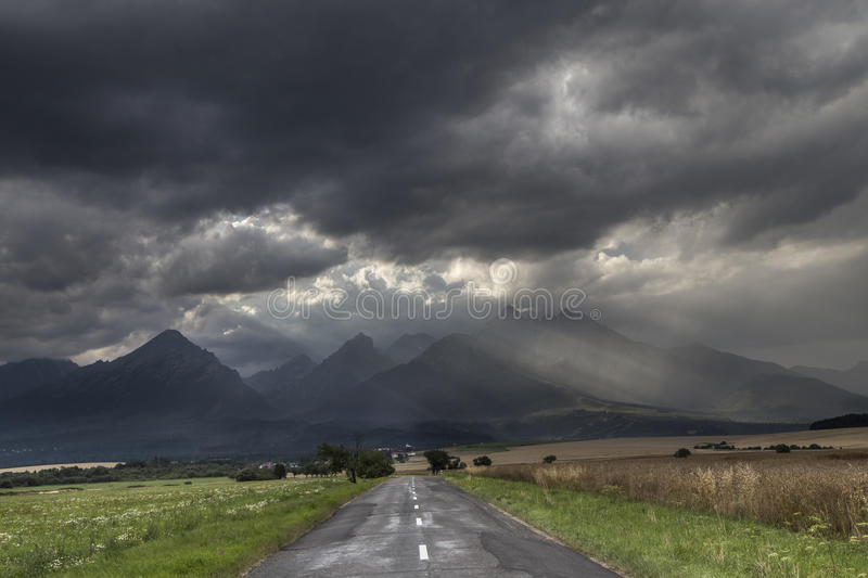 Road to high Tatras with dramatic sky royalty free stock photo