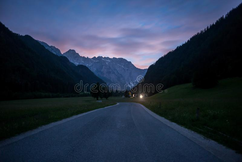 Road to Julian Alps mountains at sunset, Slovenia royalty free stock images