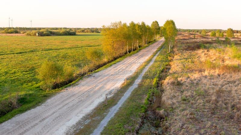 Road to the Lengener Meer. A sand road to the Lengener Meer near Uplengen stock images
