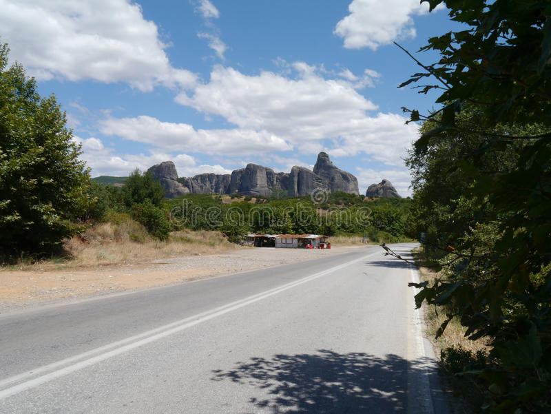 Road to Meteora, Northern Greece. Shack and Meteora rocks in landscape stock image