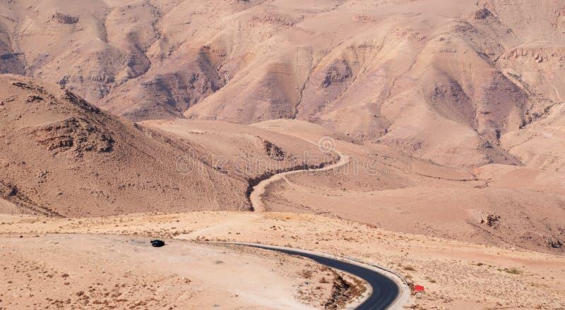 Mount Nebo, road, Jordan, Middle East, desert, landscape, climate change. Jordan 05/10/2013: Jordanian and desert landscape with the winding road to Mount Nebo stock photography