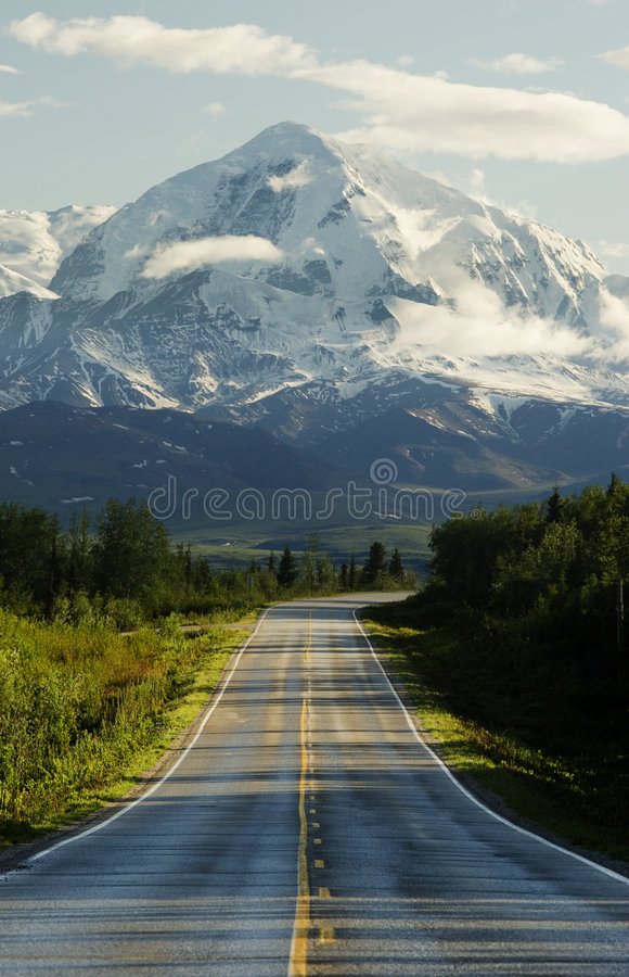 Road to mountains. Composite image (3 original images used) of some of the places in the middle of nowhere called Alaska. Mount Hayes in the background, and