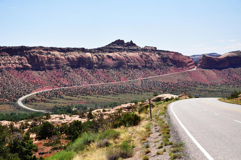 Road to Natural bridges. A scenic view of the curvy highway leading to the Natural bridges monument in Utah stock photos