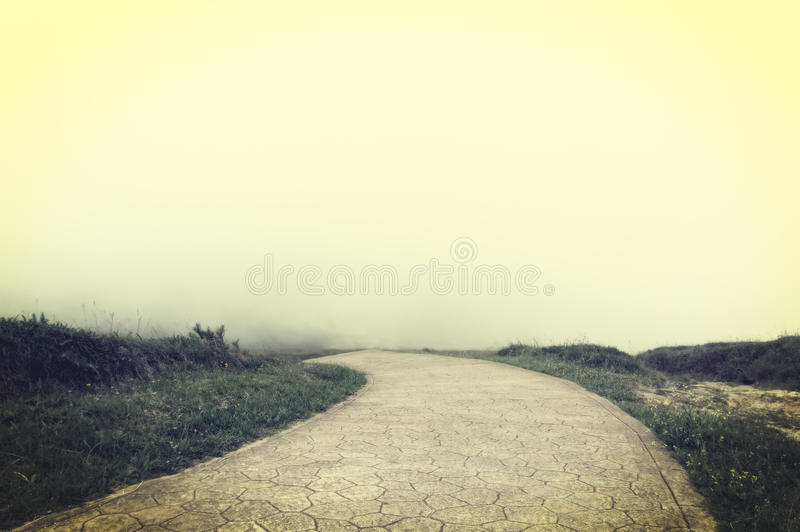 Road to nowhere with vintage filter effect. Road to nowhere with fog and vintage filter effect stock photography