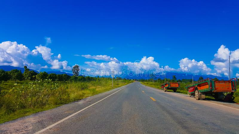 Road to Oral mountain. Oral mountain is the tallest mountain in Cambodia. And the scenery along the road to this mountain is breathtaking. And it& x27;s quite an stock photo