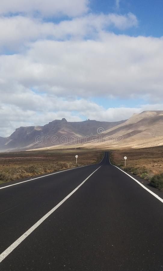 Road to paradise. Road to the beach of Famara in Lanzarote Spain royalty free stock photo