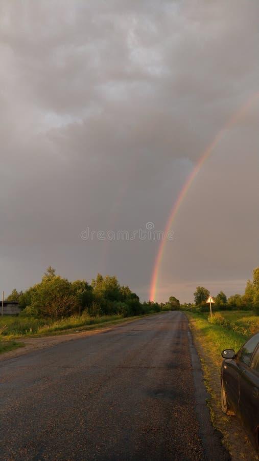 Road to rainbow stock photos