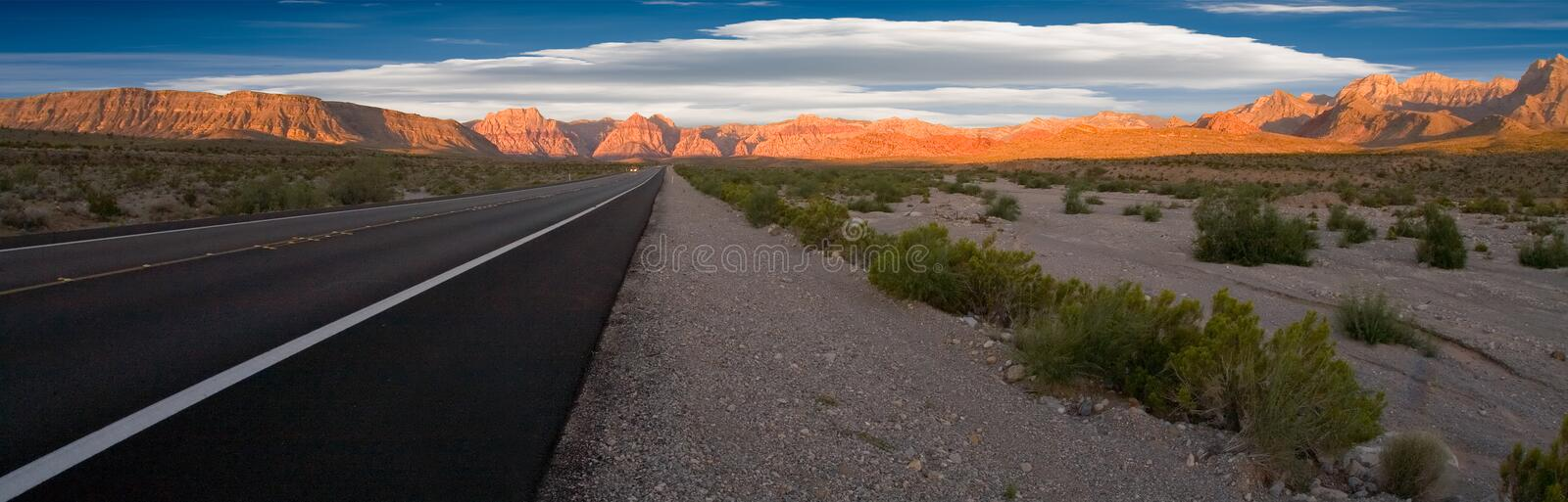 Road to Red Rock Canyon. The road to Red Rock Canyon, Nevada early in the morning with the mountains in the background royalty free stock photography