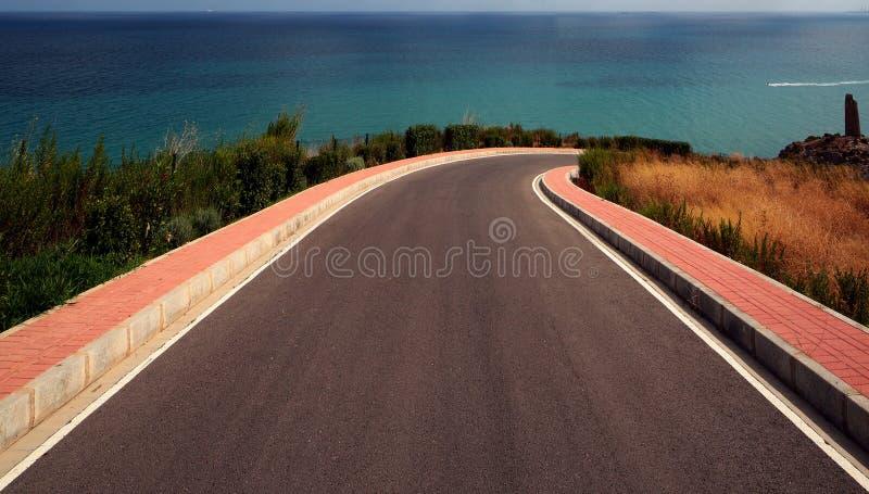 Road to the sea stock photos