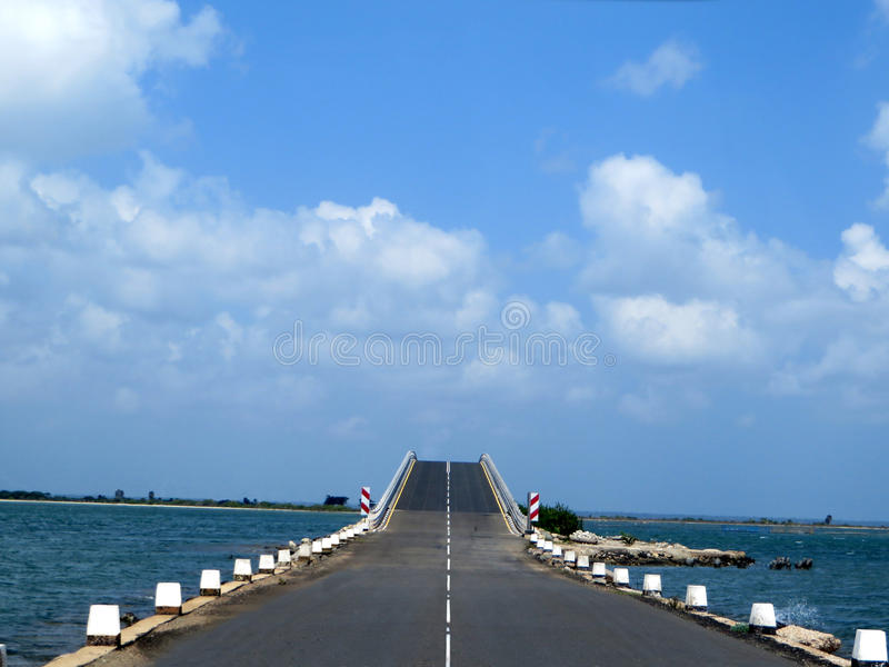 Beautiful sunny sky with asphalt highways road in coastal area stock image