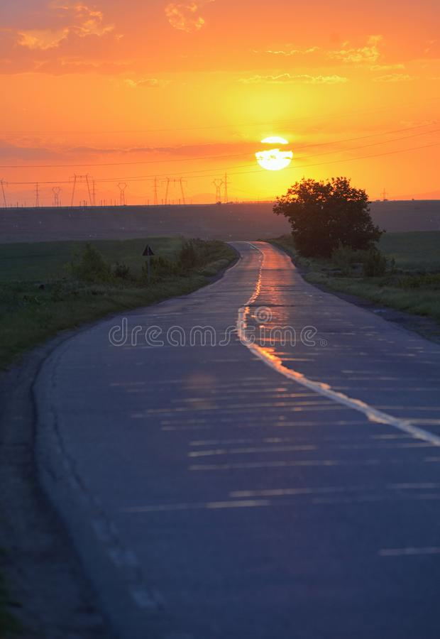 Road to the sunset stock photos