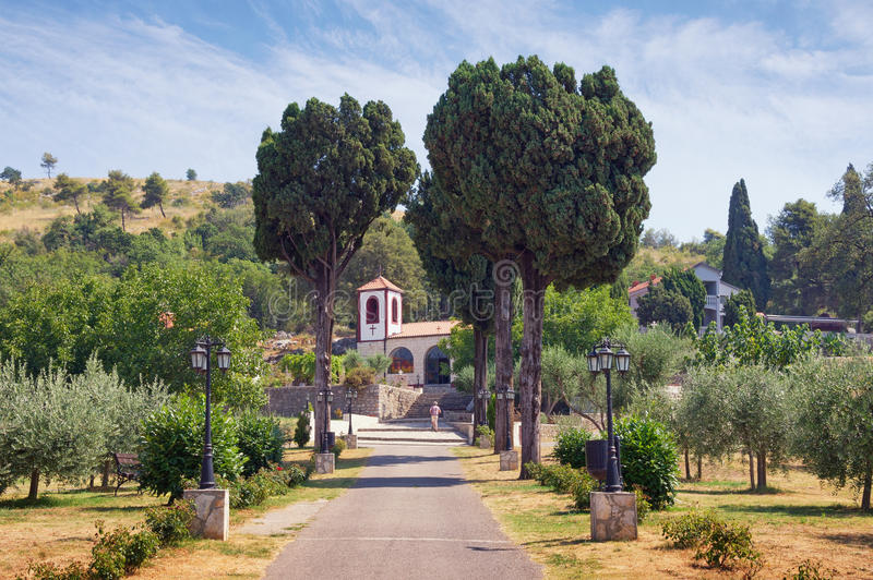 Road to the temple. View of Dajbabe Monastery. Podgorica, Montenegro. View of Serb Orthodox Christian Monastery of Dajbabe, the church is located in the cave royalty free stock photo