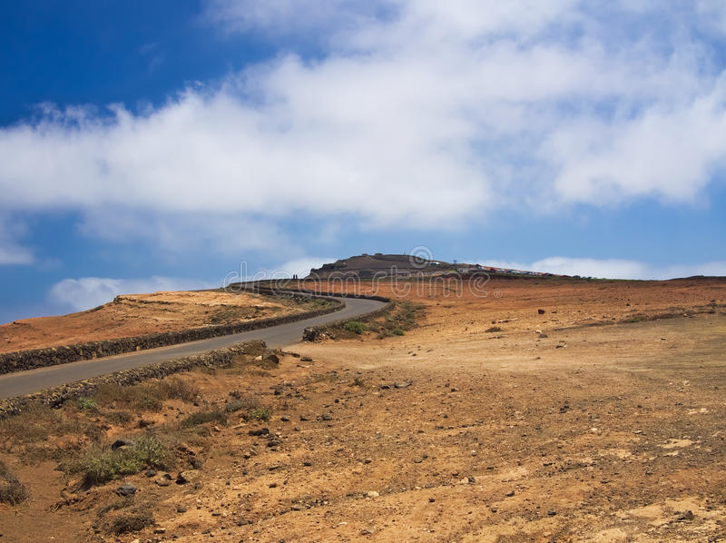 The road to the top of the mountain Mirador del Rio on background blue sky. stock photo