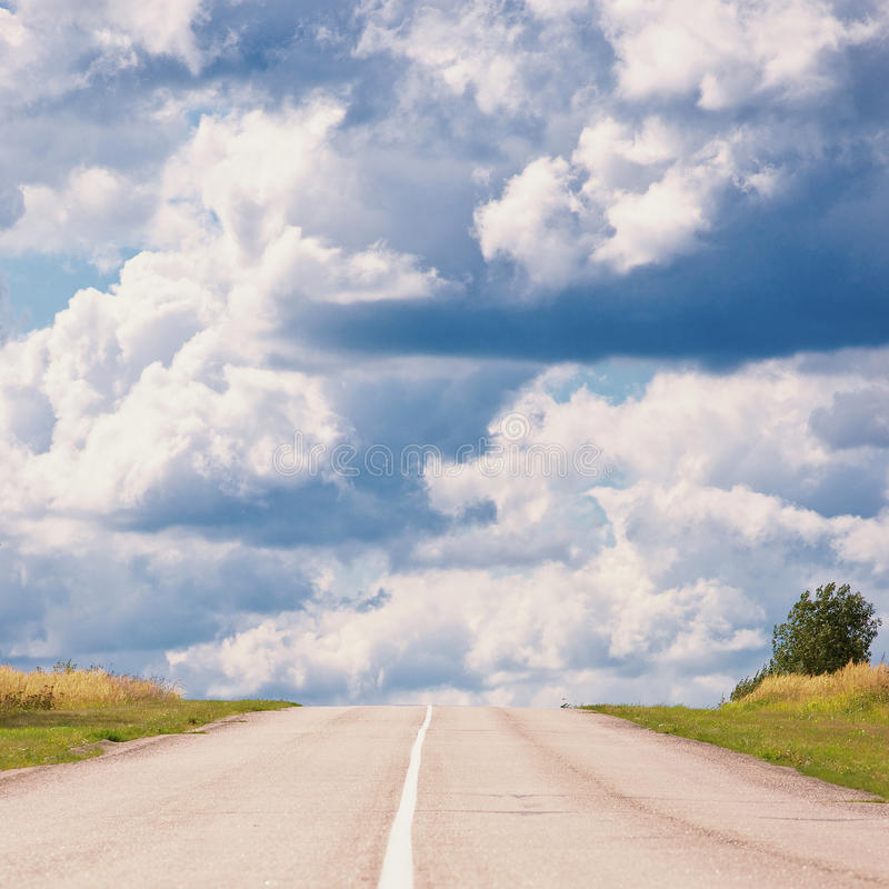 Road to uncertainty. Vanishing rural road, uncertainty concept stock images