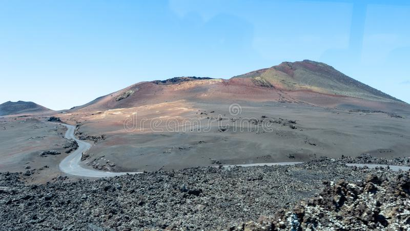 Road to volcano, amazing volcanic landscape of Timanfaya national park, Lanzarote, Canary Islands stock photography