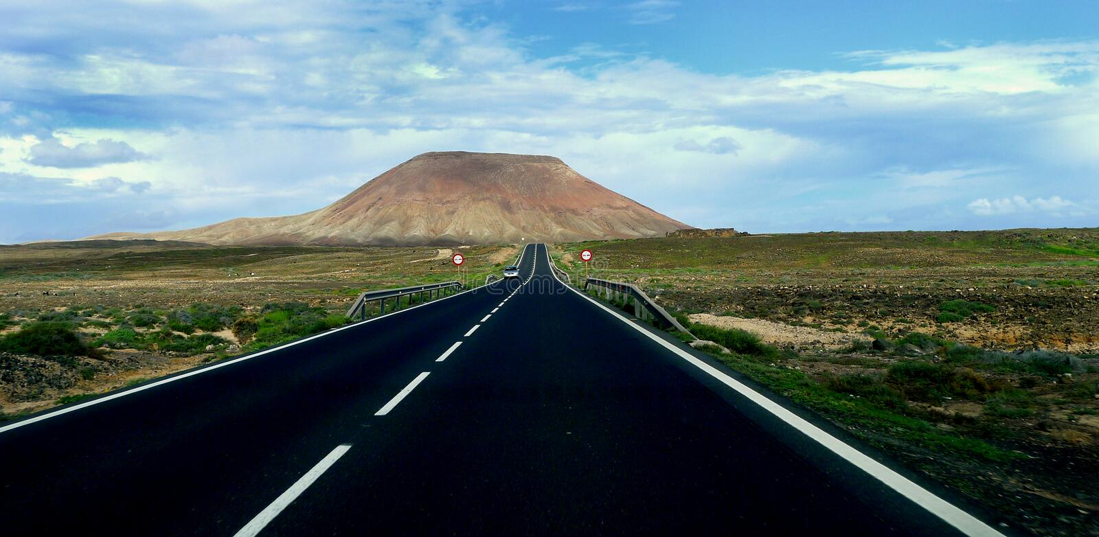 The road to the volcano. Isle of Fuerteventura Spain. One of the many extinct volcanoes that can be encountered on the drifting road and offshore on the island