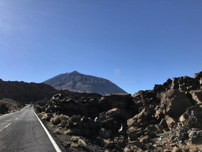 Road towards mount Teide. Road through Teide National Park towards mount Teide on Tenerife Canary Islands royalty free stock image