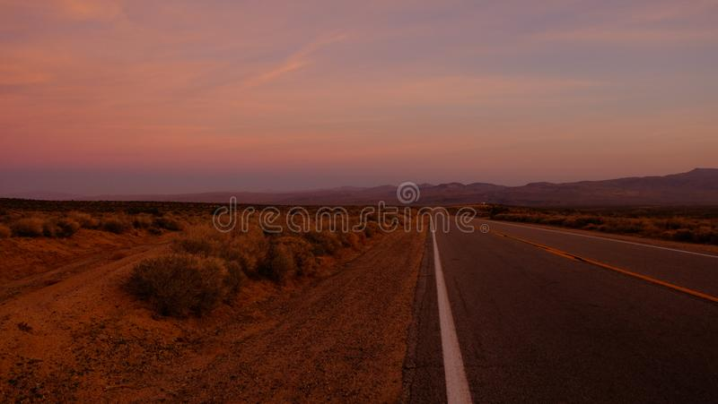 Road Towards Mountain during Sunset royalty free stock images
