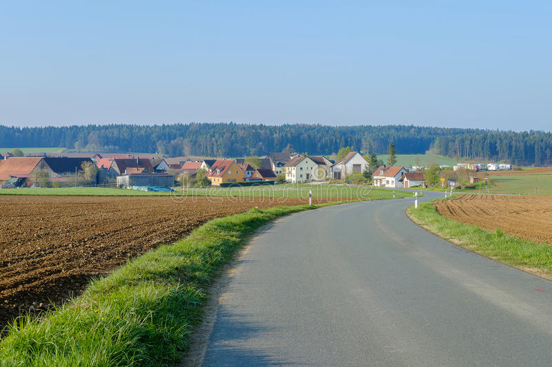 Road into the town. The road heading into the small town stock image