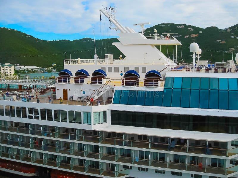 Road Town, Tortola, British Virgin Islands - February 06, 2013: Cruise ship Mein Schiff 1 docked in port. Caribbean at Road Town, Tortola, British Virgin royalty free stock photo