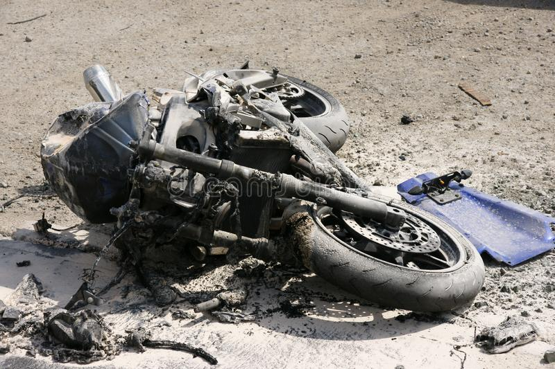 Road traffic accident, motorbike crash. Road traffic accident, fatal motorbike collision, bike crash and fire stock photography