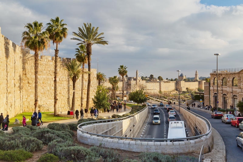 Road traffic along the wall of the old city of Jerusalem stock photography