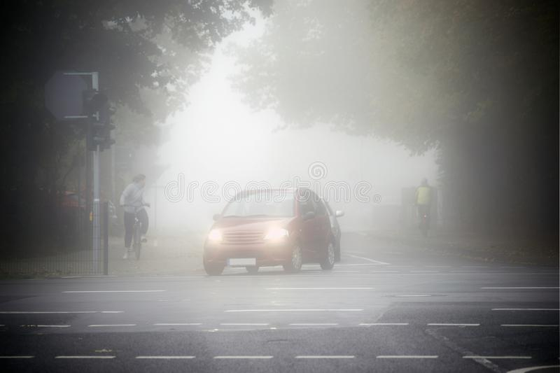 Road traffic in the fog royalty free stock image