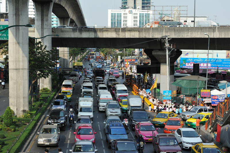 Road Traffic. Traffic nears gridlock on a busy road in the city centre on January 25, 2013 in Bangkok, Thailand. Annually an estimated 150,000 new cars join the stock photos