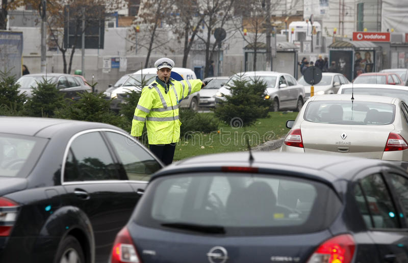Road traffic police. Police on the road guides cars through heavy traffic, downtown Bucharest, Romania stock image